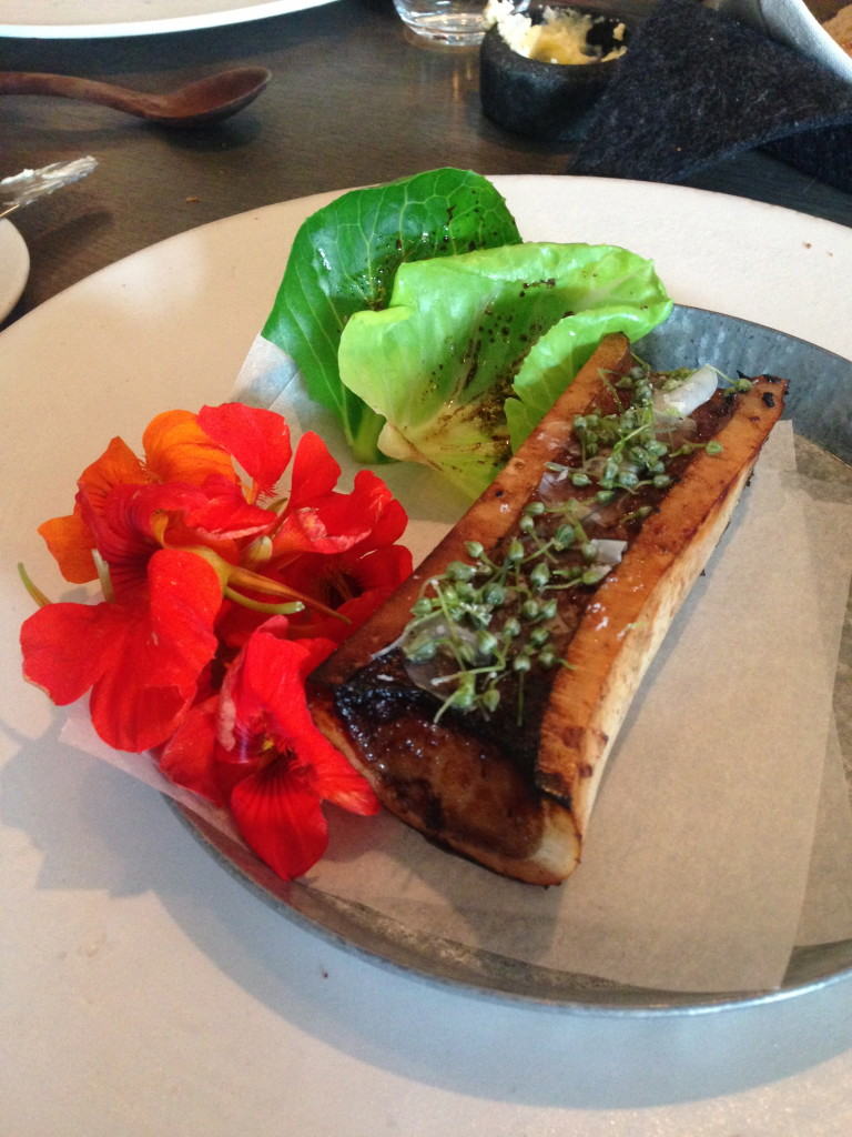 Bone marrow, nasturtium flowers, and cabbage leaves
